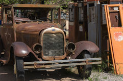Antique Car and Gas Pumps stock photo