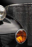 Antique car grill. The chrome grill and headlights of an antique classic car Stock Image