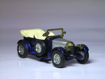 Antique car model. Details of a toy or model antique car. Isolated background Royalty Free Stock Photography