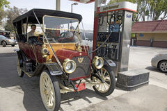 Antique car at modern gas station Stock Image