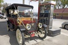 Antique car at modern gas station. In Santa Paula, CA Stock Image