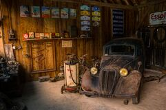 Antique car in old garage Royalty Free Stock Photography