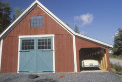 An antique car parked in a barn garage Stock Photo