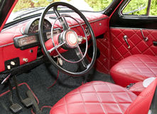Antique car with red interior inside Stock Image