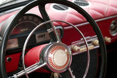 Antique car with red interior inside Royalty Free Stock Photography