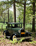 Antique car in rural scene. Royalty Free Stock Image