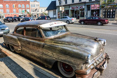 Antique car on the side of a street Stock Photo