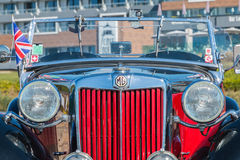 Antique car in the Street. Sables d Olonne, France  - September 23, 2016 : English vintage car rally in the streets of the city, A Nous les Belles Anglaise Stock Photo