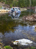 Antique car swamped by water. Royalty Free Stock Photography