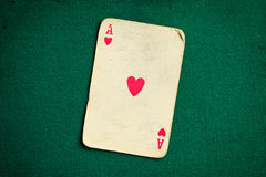 Antique card on green casino table Stock Photography