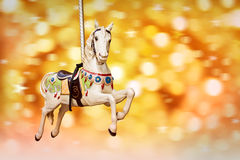 Antique carousel horse, golden festive lights Royalty Free Stock Photography