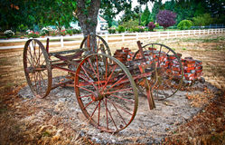 Antique Carriage on Country Farm. Antique Carriage on farm with wagon wheels royalty free stock image