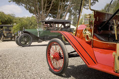 Antique cars parked in an orange grove Stock Photos