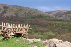 Antique cart. Old cart, standing in a meadow in the mountains Royalty Free Stock Photography