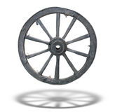Antique Cart Wheel with shadow Stock Photography