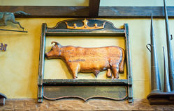 Antique carved cow sign. An antique wooden sign of a cow or bull used as a decorative farmhouse wall hanging Stock Photography