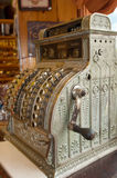 Antique cash register. In a setting suggestive of an old general store; selective focus Royalty Free Stock Photography