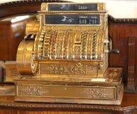 Antique cash register. Antique vintage gold color cash register Royalty Free Stock Images