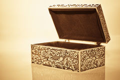 Antique casket. Old vintage metallic retro casket over white background with reflection Royalty Free Stock Photo