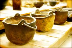 Antique cast iron pots Royalty Free Stock Image