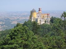 Castle of Sintra in top to a hill with a forest of trees around and after all the fields. Portugal. Antique castle. Castle in top to a hill. Forest of trees stock image