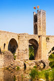 Antique catalal city gate at medieval bridge Stock Images