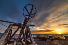 Antique catapult in Alghero seafront at sunset Royalty Free Stock Image