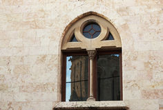 Antique cathedral window in Tarragona. With reflection main temple bell tower Stock Photography