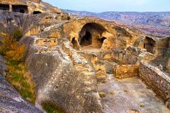 Antique cave city Stock Images