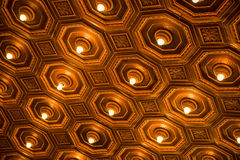Antique ceiling with lights. Beautiful antique ceiling with lights with gold and brown tones Royalty Free Stock Image