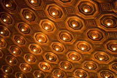 Antique ceiling with lights. Beautiful antique ceiling with lights with gold and brown tones Stock Photo