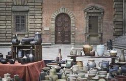 Antique ceramic dishes. Antique goods square market in Florence on the square Santissima Annunziata in the center of town. Basilica Santissima Annunziata on the Stock Photo