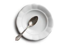 Antique ceramic plate and silver spoon Stock Photo