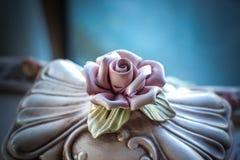Antique ceramic rose Stock Photos