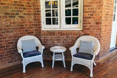 Antique chair. Antique chair with brick background royalty free stock image