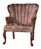 Antique chair. Beautiful antique padded chair isolated on white background Royalty Free Stock Photo