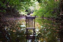 Antique Chair in Brook Royalty Free Stock Photography