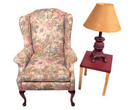 Antique chair and lamp Stock Images