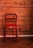 Antique chair on the old wooden wall background Royalty Free Stock Image