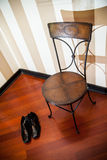 Antique chair and shoes Royalty Free Stock Photo