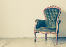 Antique chair. Vintage and antique chair with white wall background royalty free stock image