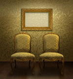 Antique chairs in golden room Royalty Free Stock Images