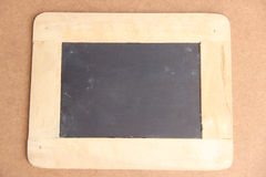Antique chalkboard with wooden frame. On wood background stock photo