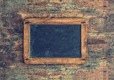 Antique chalkboard on wooden texture. Nostalgic background Royalty Free Stock Image