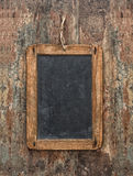 Antique chalkboard on wooden texture. Rustic background Stock Image