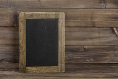 Antique chalkboard on wooden texture. Rustic background royalty free stock photography