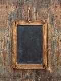 Antique chalkboard on wooden texture. Rustic background Stock Images