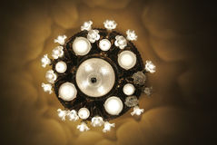 Antique chandelier with lights on Royalty Free Stock Photo