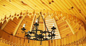 Antique chandelier and wooden ceiling. Royalty Free Stock Photography