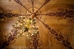 Antique chandelier on wooden ceiling Royalty Free Stock Photography
